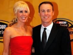 Kevin Harvick, right, and his wife, DeLana, pose for a photo before the season-ending awards ceremony in Las Vegas on Dec. 2. DeLana is 14 weeks pregnant, Kevin said, meaning she would have been pregnant in this picture.