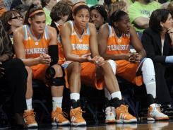 Tennessee players watch the final minutes of an historic loss to Notre Dame on Monday.