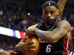 LeBron James scored 13 of his 32 points at the free throw line -- including the Heat's last six points of the game -- in Miami's road win over Detroit on Wednesday.