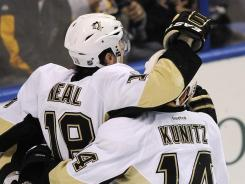 Pittsburgh Penguins winger James Neal (18) is congratulated after scoring his 27th goal of the season on Tuesday night.