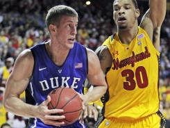 Duke forward Mason Plumlee (5) drives to the basket during the first half against Maryland forward Ashton Pankey at the Comcast Center.