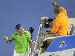 Rafael Nadal of Spain, left, argues with chair umpire Carlos Bernardes over a line call during his quarterfinal victory against Tomas Berdych of the Czech Republic.