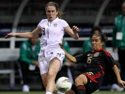 U.S. forward Heather O'Reilly (9) fights for the ball with Mexico's Rosario Saucedo during the first half in Vancouver.