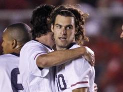 Graham Zusi celebrates with teammates after scoring the game-winning goal for the U.S. during a friendly match against Panama in Panama City.