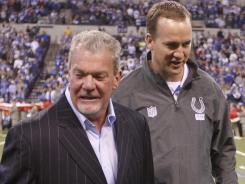 Peyton Manning, right, has been a member of Jim Irsay's Colts since 1998.