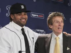 Prince Fielder stands next to Detroit Tigers team owner Mike Ilitch during his introduction at Comerica Park.