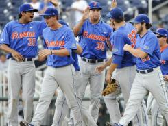 Florida narrowly beat out two-time defending champion South Carolina for the top spot in the USA TODAY/ESPN preseason baseball poll.