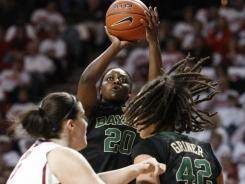 Baylor guard Terran Condrey shoots as teammate Brittney Griner (42) works against an Oklahoma player during Thursday's game.