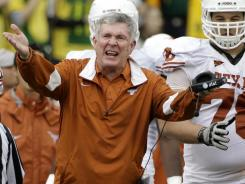 """For 14 years, he's had tremendous success on the field and equally important, he's represented the university with class, with integrity,"" Texas President Williams Powers Jr. said about Mack Brown, above."