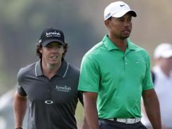 Rory McIlroy and Tiger Woods walk together during the first round of the Abu Dhabi HSBC Golf Championship in Abu Dhabi, United Arab Emirates. McIlroy grabbed a share of the early lead with a 5-under 67. Woods shot a 2-under 70.
