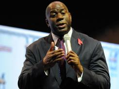 Magic Johnson, seen here at a November 2011 press conference, and his ownership group have made it past the first round in their bid for the Los Angeles Dodgers.