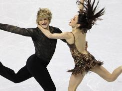 Charlie White, left, and Meryl Davis took a commanding lead in the ice dance competition at the U.S. Figure Skating Championships.