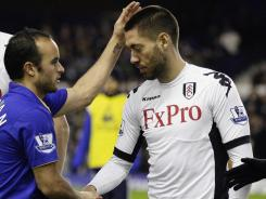 Everton's Landon Donovan (left) shakes hands with Fulham's Clint Dempsey before their FA Cup fourth round soccer match at Goodison Park in Liverpool, England, Friday.