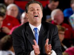Kentucky coach John Calipari claps during the second half of the team's game against Georgia at Stegeman Coliseum. Calipari and his No. 1 Wildcats received a piece of fan mail this week from a dog.