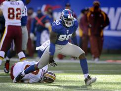 Giant defensive end Jason Pierre-Paul celebrates after taking down Redskins quarterback Rex Grossman on Dec. 18 for one of his 16.5 regular-season sacks, fourth most in the NFL