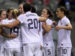 United States teammates celebrate Tobin Heath's (17) goal against Costa Rica during the first half of CONCACAF women's Olympic qualifying at B.C. Place in Vancouver on Friday.
