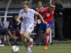 Wendy Acosta of Costa Rica pulls on the jersey of Heather O'Reilly of the United States as she tries to catch up during the first half of semifinals action of the 2012 CONCACAF Women's Olympic Qualifying Tournament on Friday in Vancouver.
