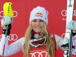 Lindsey Vonn celebrates after winning Friday's World Cup super-combined event in St. Moritz, Switzerland.