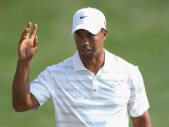 Tiger Woods acknowedges the cheers during the second round of the Abu Dhabi HSBC Golf Championship.