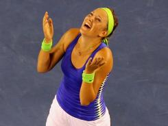 Victoria Azarenka of Belarus celebrates her 6-3, 6-0 victory against Maria Sharapova of Russia to claim the Australian Open title, her first major, and the No. 1 ranking.