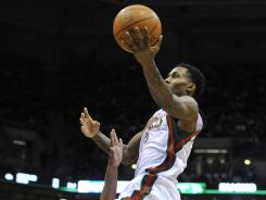 Lakers guard Andrew Goudelock defends as the Bucks' Brandon Jennings glides in for two points during the second half Saturday in Milwaukee.