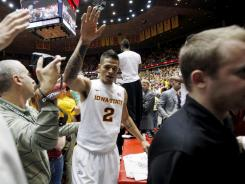 Iowa State guard Chris Babb celebrates with fans after his team's 72-64 victory over Kansas.