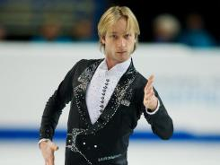 "Evgeni Plushenko skated to ""Tango de Roxanne"" from the Moulin Rouge soundtrack to score a personal-best 176.52 points in the free skate."