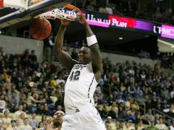 Panthers center Talib Zanna dunks against the Hoyas during the first half.