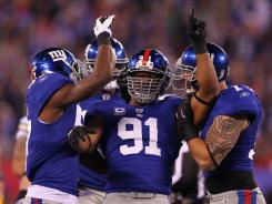 """Justin Tuck (91) has had to deal with physical and emotional pain this season — various injuries and the death of his grandfather and two uncles. """"There were a lot of times when I thought, 'I don't want to play this game anymore,' """" he says."""