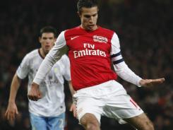 Arsenal's captain Robin Van Persie shoots a penalty kick to score against Aston Villa during the English FA Cup fourth round soccer match at the Emirates Stadium in London on Sunday.