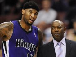 Keith Smart, right, took over as Sacramento Kings coach on Jan. 5 after Paul Westphal was fired, in part, for a dysfunctional relationship with center DeMarcus Cousins, left.