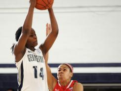 Georgetown guard Sugar Rodgers grabs a loose ball in front of Rutgers guard Nikki Speed during Sunday's second half.