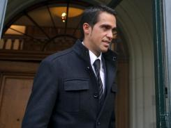 In a file photo from Nov. 24, 2011, three-time Tour de France champion Alberto Contador leaves after the final day of his hearing before the Court of Arbitration for Sports in Lausanne.