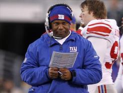 Not known as a screamer, Giants defensive coordinator Perry Fewell offered some animated criticism to fire up his struggling unit.
