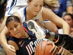 Duke Blue Devils guard Tricia Liston, top, battles Connecticut Huskies forward Kaleena Mosqueda-Lewis for a loose ball during the first half at Cameron Indoor Stadium.