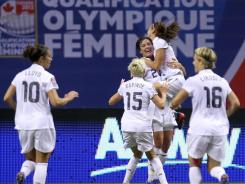 Abby Wambach (20) celebrates her goal against Canada with teammates Alex Morgan, Carli Lloyd (10), Megan Rapinoe (15) and Lori Lindsey (16) during the first half of the CONCACAF women's Olympic qualifying final. The U.S. won, 4-0.
