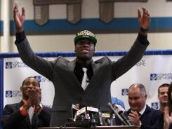 Dorial Green-Beckham celebrates after announcing that he will play college football for Missouri at a press conference at Hillcrest High School.