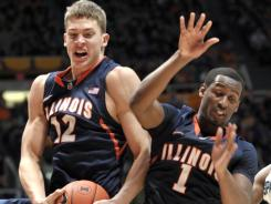 Illinois center Meyers Leonard (12) grabs a rebound from guard D.J. Richardson in the second half at Assembly Hall in Champaign, Ill.