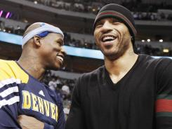 Forward Kenyon Martin, right, speaking with former Denver Nuggets teammate Al Harrington, left, could return to the NBA after playing in the fall for the Chinese Basketball Association.