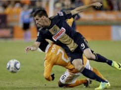 Sebastien Le Toux of the Philadelphia Union wins the ball against Corey Ashe of the Houston Dynamo in the second leg of the playoffs on Nov. 3, 2011 at Robertson Stadium in Houston.