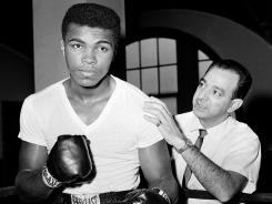 Muhammad Ali with trainer Angelo Dundee at City Parks Gym in New York on February 8, 1962. Dundee passed away Wednesday at the age of 90. By training the legendary Ali as well as Sugar Ray Robinson, Dundee became one of the biggest names in boxing.