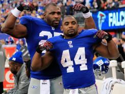 Brandon Jacobs, left, and Ahmad Bradshaw complement each other as New York's primary ball carriers. In the postseason, Bradshaw has rushed for 200 yards on 46 carries and Jacobs has gained 127 yards on 28 attempts.