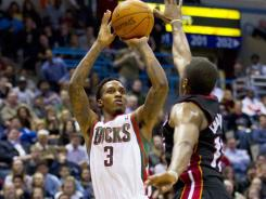 Brandon Jennings (3) had 31 points and eight assists to lead the Bucks over the Heat for the second time this season.