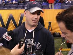 Double duty:  Bill O'Brien, in Indianapolis as Patriots offensive coordinator, is transitioning to his new job as Penn State's head coach.