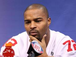 New York Giants defensive end Osi Umenyiora participates in media day in preparation for Super Bowl XLVI.