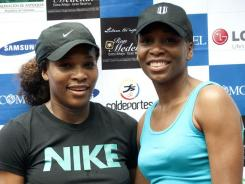 Serena and and Venus Williams, shown together at an exhibition in Colombia in November, will lead the U.S. Fed Cup team against Belarus on Saturday and Sunday in Worcester, Mass.