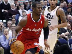 Chris Paul (3) had 34 points and 11 assists to help the Clippers end a 16-game losing streak in Utah.