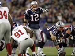 New England Patriots quarterback Tom Brady hopes find a ray of light between New York Giants defenders on Sunday.