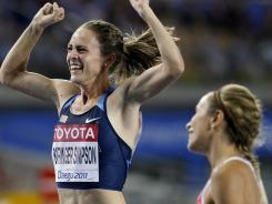 Jenny Simpson (left) celebrates gold at the world championships in Daegu, South Korea, on Sept. 1, 2011.