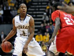Murray State's Isaiah Canaan (3) drives against Southeast Missouri's Marland Smith in the first half of an NCAA college basketball game on Thursday, Feb. 2, 2012, in Murray, Ky.
